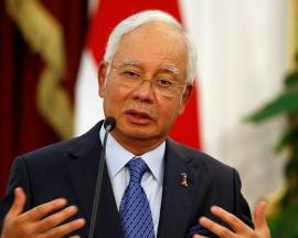 Almost $30 million seized in raids linked to Malaysian ex-PM Najib Razak