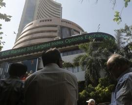 Sensex opens below 34,000, then climbs back over in volatile early trade