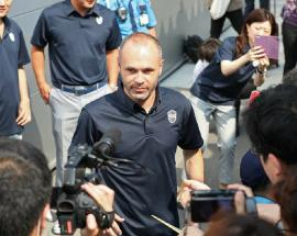 Fans cheer as Iniesta lands in Japan to join Vissel Kobe