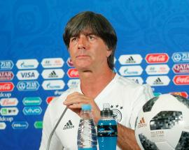 Germans put brave face on football defeat as their world wobbles