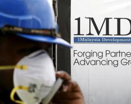 Malaysia seeks playboy financier over 1MDB scandal