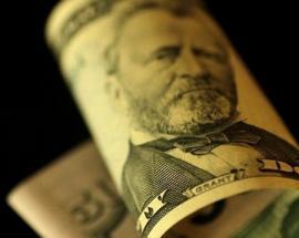 Stronger dollar traps gold near five-week lows