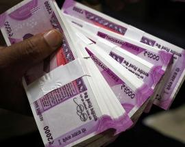 In pictures: India becomes world's sixth largest economy