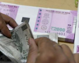 Money market: Rupee opens higher against dollar