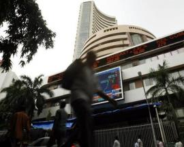 Sensex records new high, Nifty holds above 11,000