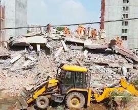 Six-storey building falls on 4-storey building in Greater Noida