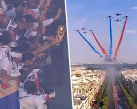 France's soccer team parades on the Champs Elysees