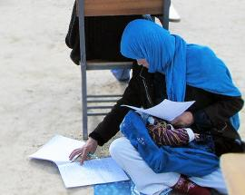 Photo of Afghan mum cradling baby during exam goes viral